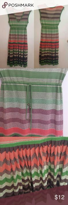 Multicolored Striped Sundress Multicolored sundress by BCBGirls. Has green, purple, white, and scarlet stripes. It is a pull-over-to-get-into dress. There is a v-neck. No sleeves. It ties at the waist, so there is a little more room. Might be able to fit a medium on the smaller side. The bottom is pleated, with zig zag stripes. It is slightly see through, so maybe wear something under it.   90% Rayon 10% Polyester   Hand wash cold separately Do not bleach  Line dry Cool iron (if needed)…