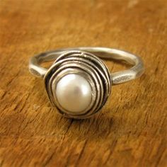 LOVE this nested pearl ring. - and this is the ring James actually gave to me!  :D