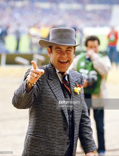 May 19,1984 Watford chairman Elton John waves to fans before the 1984 FA Cup Final between Everton and Watford at Wembley Stadium in London, England.