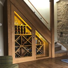 This beautiful under stairs wine storage is made from oak with hexagonal shelving to give a contemporary feel. What an amazing use of dead space. Bar Under Stairs, Under Stairs Wine Cellar, Space Under Stairs, Under Stairs Cupboard, Bathroom Under Stairs, Home Stairs Design, House Design, Home Wine Cellars, Staircase Storage