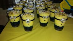 Minion layered pudding cups. Crushed Oreos on bottom for feet, blue jello in middle for the pants, vanilla pudding on top for the body and chocolate sprinkles for the hair