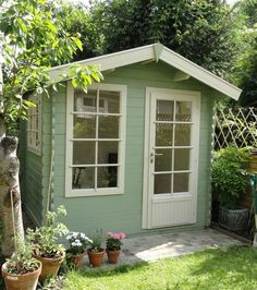 Shed colour! Keops cabin - Cuprinol Garden wood shades in Willow and Natural Stone Painted Garden Sheds, Painted Shed, Wooden Garden, Cuprinol Garden Shades, Craft Shed, Wendy House, Shed Colours, Fence Paint Colours, She Sheds