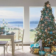 Love the seahorse, starfish and sailboat ornaments surrounded by gold and turquoise wrapped boxes.