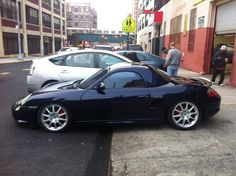 Lapis blue Porsche Boxster 986 with hard top on.