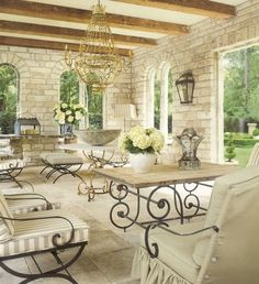 Gorgeous Outdoor Tuscan Space With Exposed Beams, Light Brick And Gold  Chandelier Ideas