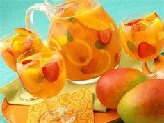 Mango-Lime Sangria. Yummy! Loving fresh mango lately and Sangria is always good!
