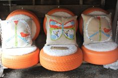 tires turned seats.  Cute for garage, by outside play area, by garden perhaps?