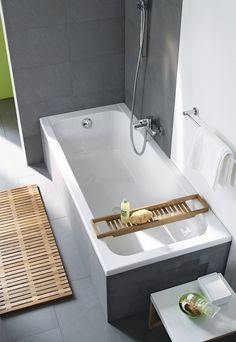 If there are space constraints, I like the streamlined tiled finish around tub instead of huge heavy deck.