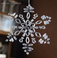 beaded snowflake - looks like it needs wire to keep the delicate shape from collapsing