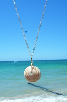 Purple puka shell on 18 inch 14K gold filled chain. Puka shell is approximately 3/4 inch diameter. Simple, delicate, ocean inspired! I can make this necklace with any one of the puka shells pictured. Just send me a message and let me know which one you like. I can also do this