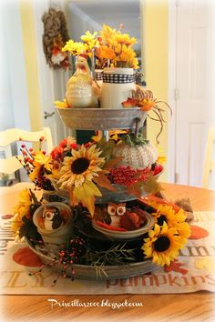 Fall Galvanized Centerpiece I am still loving this galvanized tray I got from Sam's club ! I have dressed it up for Fall with sunflowers , fall berries and leav. Galvanized Tiered Tray, Galvanized Decor, Thanksgiving Decorations, Seasonal Decor, Thanksgiving Tree, Living Vintage, Autumn Decorating, Decorating Ideas, Tiered Stand