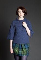 Love the knit sweater & the #flirty plaid skirt!