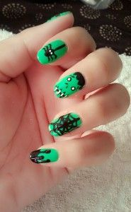 A very cute Frankenstein inspired Halloween nail art. Use a green base color that also serves as Frankenstein's skin. You can also add minor details such as spiders, webs and gore splatters on your nails.