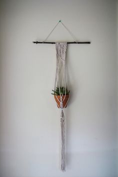 Macrame plant hanger//wall hanginging by thecraftingrachel on Etsy