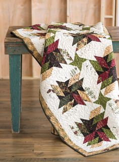 """Old Sawmill is a masculine quilt made using 2½""""-wide pre-cut strips and a diagonal seams technique, making it easy to piece. Quilting video tutorial available!"""