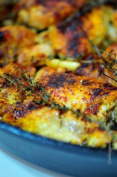 Easy Skillet Roasted Chicken: chicken thighs with skin, paprika, garlic, thyme, olive oil, salt& pepper.