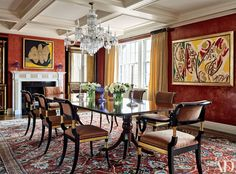 Architect John B. Murray and decorator Elissa Cullman renovated this apartment. Regency-style chairs in a Donghia fabric encircle the dining room table, while Venetian-plaster walls serve as a backdrop for paintings by Robert Motherwell (left) and Lee Krasner; the mantel is by Chesney's.