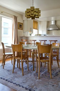 Paint colors that match this Apartment Therapy photo: SW 6048 Terra Brun, SW 7006 Extra White, SW 6264 Midnight, SW 7633 Taupe Tone, SW 9073 Dusty Heather
