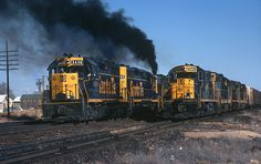 https://flic.kr/p/UyRt5f | Smoky Departure | Santa Fe GP35 3436 accelerates west out of Seligman, Arizona, on March 9, 1972, while the 9843 waits its turn. A 9800 class RSD-15 in 3436's consist makes its smoky presence. Photo by Joe McMillan.