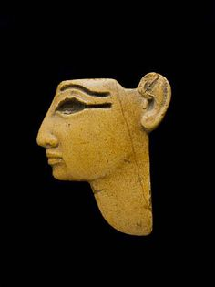 An Egyptian yellow jasper face inlay. New Kingdom, circa 1550-1070 B.C.