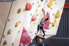 Nina Williams matches a pinch at the Front Climbing Gym in Salt Lake City. Photo: George Bruce Wilson