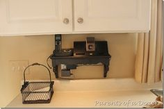 love the shelf to hide the plug & to hold the phone & chargers.....from www.twoparentsofadozenchildren.com