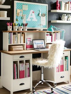 Chic office space - loving that monogrammed pinboard and that cozy chair!