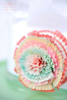 paper rosette made from cupcake liners - Baking Party  http://happywishcompany.com/