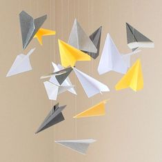 Cute Paper Airplane Mobile for boys room in navy orange green and white Airplane Mobile, Airplane Decor, Paper Airplane Party, Paper Plane, Mobiles, Paper Centerpieces, Planes Birthday, Diy And Crafts, Paper Crafts