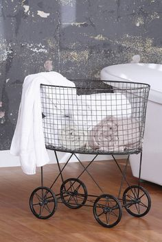 """Features:  -Casual Country collection.  -Made of iron.  -Wheels allow for easy mobility.  Color: -Gray.  Distressed: -Yes.  Primary Material: -Metal. Dimensions:  Overall Height - Top to Bottom: -27""""."""