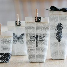 Use pages from an old book, stamp and fold them into small gift bags.