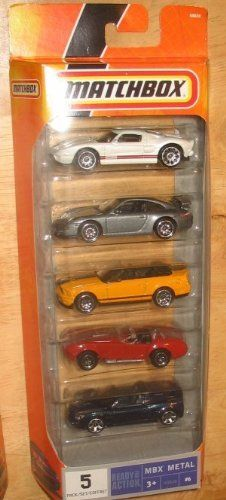"""Matchbox MBX Metal - 5 Pack - N9638 - #6 - Fancy Cars by Mattel. $24.99. 2008-dated Matchbox 5-Pack Gift Set #6. Contains: 2005 Ford GT, Porsche 911 GT3, 2007 Ford Shelby GT500, 1965 Shelby Cobra 427 S/C, Opel Speedster. Ages 3+. 1/64 scale die cast (approx. 2.5""""-3"""" each vehicle). MBX Metal. Matchbox 5-pack gift set of hi-performance vehicles. Includes white Ford GT, charcoal gray Porsche 911 GT3, yellow Ford Shelby GT500 convertible, red Shelby Cobra 427 S/C, and dark m..."""