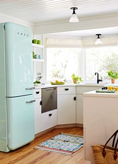 600 Square Foot Beach Cottage White Kitchen with Teal Smeg Fridge Beach Cottage Kitchens, Small Cottage Kitchen, Smeg Kitchen, Kitchen Cabinets, Smeg Fridge, Kitchen Taps, Cupboards, Kitchen Styling, Kitchen Decor