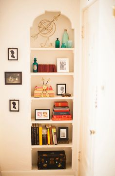 """Sneak Peek: Nicole Sutton of Workhorse. """"I love these built-in shelves! I mean, who doesn't love a good vignette, right? Some of my prized items live here: baby photos of me and my sis, an old French glass bottle that Zoe brought me back from Paris, a few favorite reads and some great silhouettes I found back home in Philadelphia."""" #sneakpeek"""