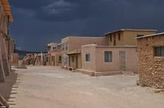 Nearly 50 tribal members live year round on the Mesa. Over 3000 tribal members live in surrounding villages. The pueblo is a Registered National Historic Landmark. In this photo you can see the black clouds which brought thunder, lightning and rain. Clear mornings and afternoon thundershowers are the norm this time of year (June).
