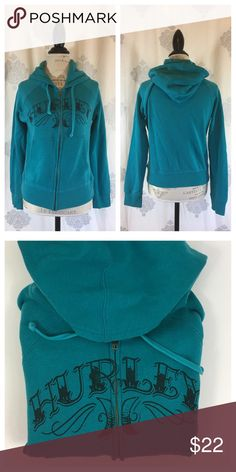 Hurley Sweatshirt Hurley zip up hoodie in a fun, bright turquoise wth black logo graphic. Good used condition, some mild pilling typical of sweatshirts. Offers welcome using the Offer button. No trades. Hurley Tops Sweatshirts & Hoodies