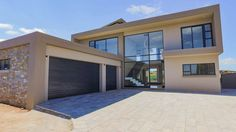 """The Perfect 10"""" - this marvellously modern home overlooks the 10th fairway and offers awe inspiring views, perfect for sipping cocktails under balmy velvet skies on tranquil summer evenings...  HomesInJohannesburg #PropertyForSale #JHB #Gauteng #ResidentialEstates"""