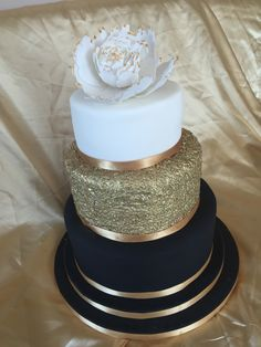 Black, gold and white wedding cake