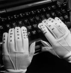 A close-up of the lettered and numbered gloves used for teaching touch typing.  (Photo by Frank Martin/BIPs/Getty Images)