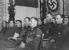 """A SS leaders attend a conference in Mostar. Seated in the first row from right to left are SS-Obergruppenfuehrer Krueger, SS-Sturmbannfuehrer Eberhardt, SS-Sturmbannfuehrer Moreth, SS-Sturmbannfuehrer Hahn. The original Waffen-SS caption reads """"Fuehrerbesprechung am 31.1.1944 in Mostar"""" (leaders' conference on January 31, 1944 in Mostar)."""