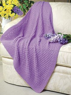 "Lilacs in Bloom -- Knitting --(from website) Reader Favorite!This beginner level project works up quickly on size 11 needles with chunky-weight yarn. Size: 43"" x 43"". Skill Level: Beginner"