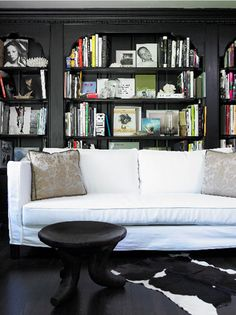 I have a big fat wall and this would work.  bookshelves behind sofa...