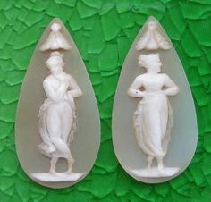 Two danccers    Materials: shell.  Date and origin: ca 1830-40.  Size of the cameo: 1 1/4 by 5/8 inch  Condition: flawless.       Very rare pair of drop cameos for earrings.  Higly desirable collectors piece.