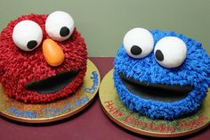 elmo and cookie monster ball cakes; one of these as Kayce's smash cake.