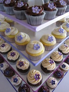 Examples of purple blossoms on cupcakes