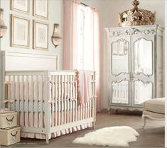 you can see the cream crib with adistressed gray piece furniture together