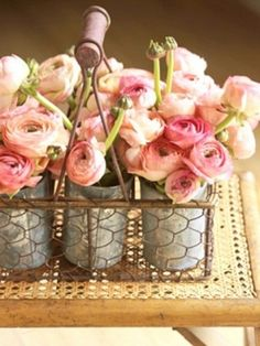 ranunculus. the chicken wire brings in the good ol'country feeling. It's country meets romantic. love it.