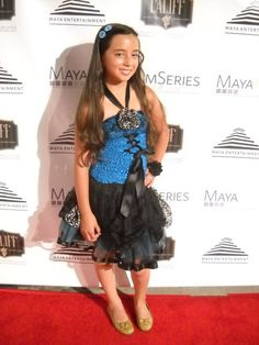 """Gabi Holland wearing Dainty Lions double snap headband with """"Molly"""" turquoise bling button snaps. Also wearing black interchangeable flower snap on wrist  www.facebook.com/DaintyLions11  www.daintylions.com  #accessories #tween #teen #bling #interchangeable #redcarpet"""