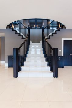 The grand split staircase is the first thing you see when you enter the home. Interior Design Your Home, Home Stairs Design, Home Building Design, Dream Home Design, Modern House Design, Building A House, Luxury Staircase, House Staircase, Modern Staircase