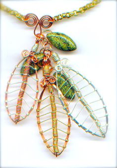 She made coils that she strung like beads for the mid-vein of the leaf.  Makes this project easier than it looks at first glance.